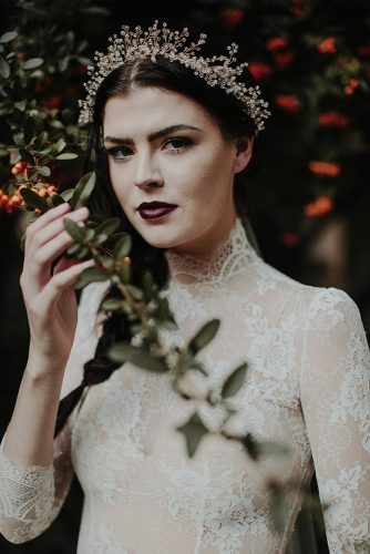 halloween wedding ideas gothic image of the bride in a tight lace dress with dark lips and diadem tyler branch
