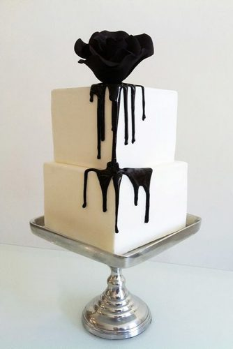 halloween wedding ideas white two tiered cake with a black rose white cakery co
