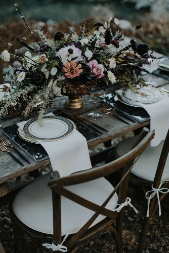 halloween wedding ideas wooden table decorated with a dark bouquet mysterious tyler branch