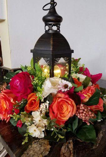 lantern wedding centerpiece ideas black lantern bright flower luxuryislandweddings