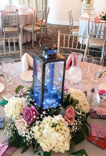 lantern nwedding centerpiece ideas lantern bliue light flowersbyfloydharbor