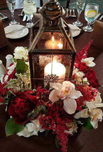 lantern wedding centerpiece ideas lantern with candle red white flower bouquetstudio