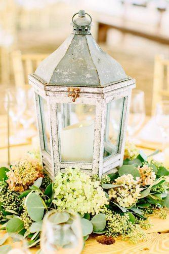 lantern wedding centerpiece ideas lantren with green flower kellydillonphotography