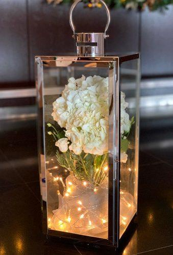 lantern wedding centerpiece ideas metallic lantern white flower eventstylingco