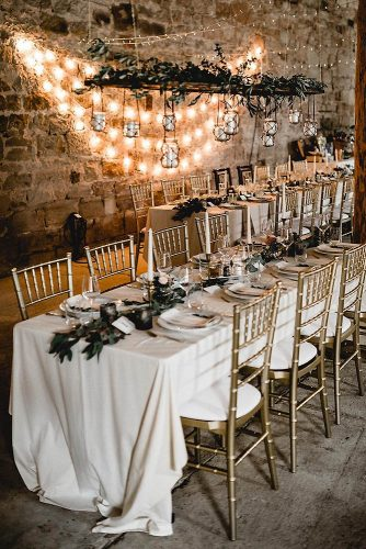 loft decorating ideas golden chairs and white tablecloth decorated with greenery on the wall lights kathiundchris via instagram