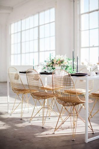 loft decorating ideas in a white room a white table with golden chairs black dishes with candles and greens on the table fine art photographer via instagram