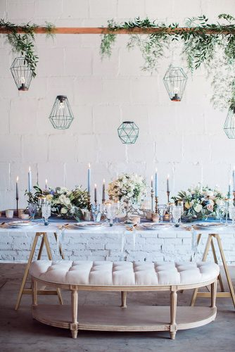 loft decorating ideas light reception desk with white flowers and blue candles over a table geometric lamps and greens fine art photographer via instagram