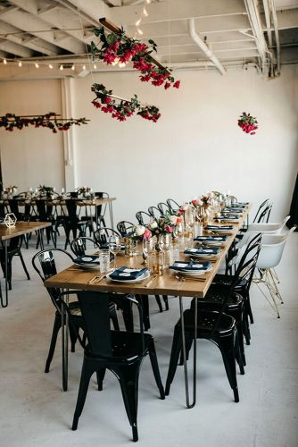 loft decorating ideas reception in modern style wooden table black chairs and serving under the ceiling and on tables red flowers nicole leever