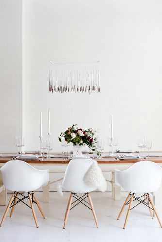 loft decorating ideas reception in the art nouveau style with white walls chairs and candles on the table flowers blue rose photography