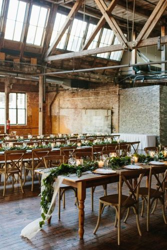loft decorating ideas rustic reception with wooden furniture on the table greens and candles nicki sebastian