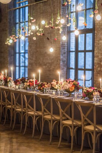 loft decorating ideas table decorated with flowers and candles over the table flowers and light bulbs leila brewster