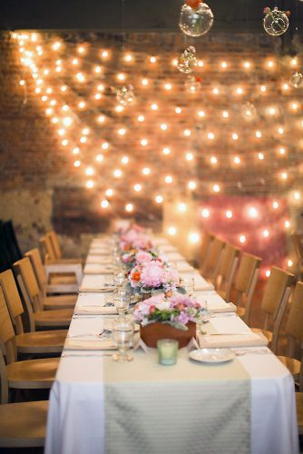 loft decorating ideas wedding reception in a loft decorated with bright colors and luminous garlands first comes love
