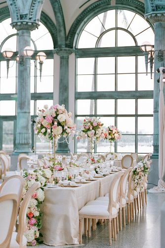 loft decorating ideas wedding reception in a loft with large windows with elegant tables decorated with flowers elizabeth messina via instagram