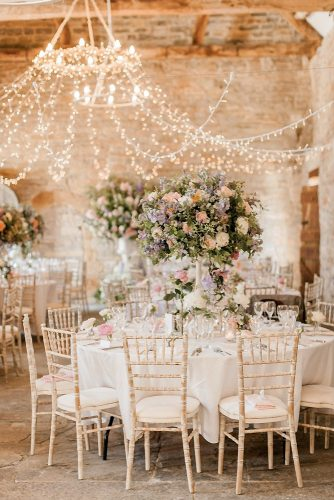 loft decorating ideas wedding reception in a loft with round tables and high vases with flowers naomi kenton