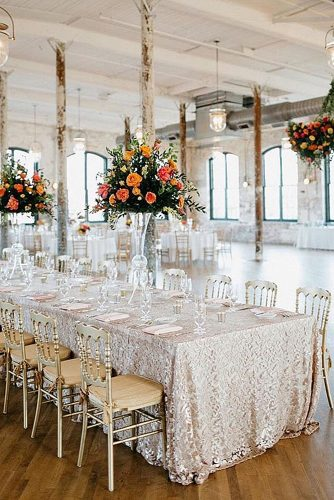 loft decorating ideas white loft with golden tablecloth and chairs orange bouquets on the table monika gauthier photography via instagram