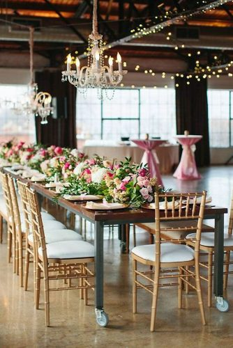 loft decorating ideas wooden table decorated with pink flowers and greenery elegant chandeliers sara and rocky photography