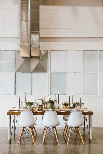 loft decorating ideas wooden table golden vases candles white modern chairs in the industrial loft ashleigh cropper via instagram