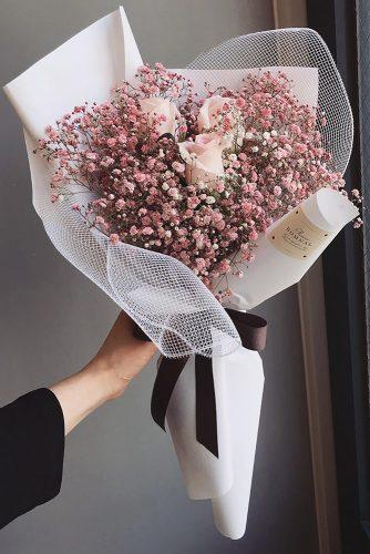 pink wedding bouquets pink baby breath and roses in paper with ribbon flower.bomnal