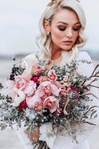 pink wedding bouquets small elegant with orchids peonies and greenery theevokecompany