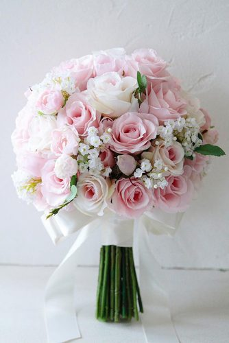 pink wedding bouquets with blush roses small white flowers and green leaves weddingbouquet jp