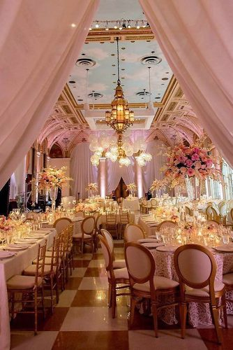 rose gold wedding décor elegant wedding reception in golden pink tones with high flower vases on the tables and a cloudy sky on the ceiling chris joriann photography