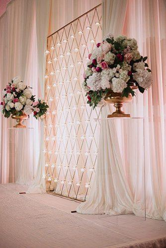 rose gold wedding decor backdrop golden with lanterns decorated with flowers in golden vases shaun menary photography