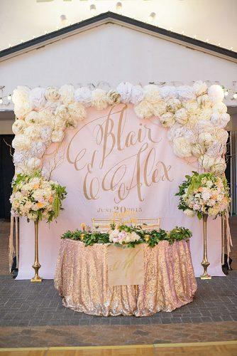 rose gold wedding decor background with names of the bride and groom decorated with flowers clint brewer photo