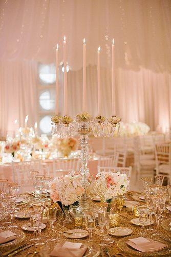rose gold wedding decor candlestick crystal with five pink candles on a table with golden decorations josh elliott