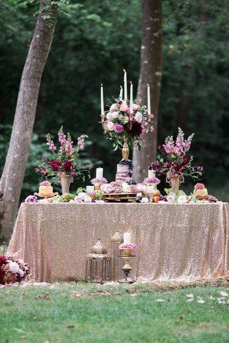 rose gold wedding decor dessert table with a bare cake with flowers and candles jenny owens photography