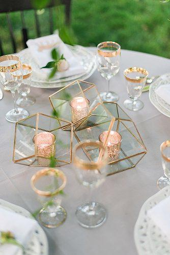 rose gold wedding decor pink gold candlesticks in geometric vases kathryn ivy photography