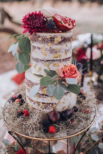 small rustic wedding cakes naked cake with golden ornaments fresh flowers with berries and pomegranate rachel lynn photography via instagram