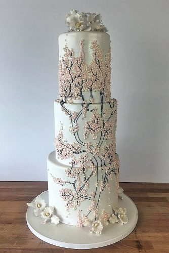 unique wedding cakes tall white with branches and pink mother of pearl charm city cakes via instagram