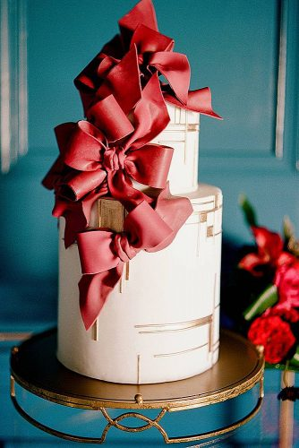 unique wedding cakes white with voluminous red bows lisa blume photography via instagram
