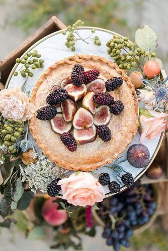 wedding cake alternatives fruit pie on a dish decorated with flowers lundy photography via instagram