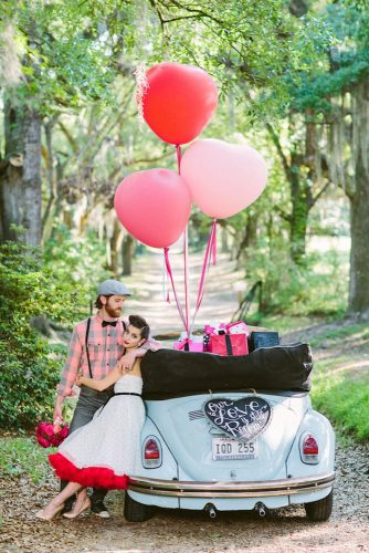 wedding car decorations balloons and a heart with an inscription decorate the car the bride and groom in retro style ashleigh jayne photography