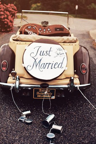 wedding car decorations beige retro car decorated with inscription and tin cans peter van beever photography