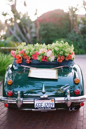 wedding car decorations dark green car decorated with greenery and red flowers boda planes