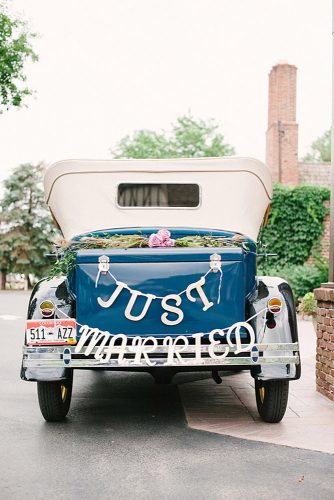 wedding car decorations decorated with green roses and inscription just married sarah joelle photography