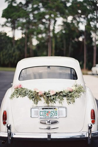 wedding car decorations green and tender roses decorate a white car judy pak photography