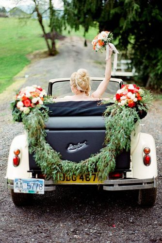 wedding car decorations greens and white red roses decorate the car kirill bordon