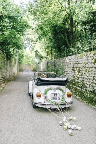 wedding car decorations heart of greenery and flowers tin cans sarah jane ethan photography