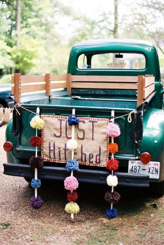 wedding car decorations the green pickup is decorated with burlap with the inscription and colored buboes kate benson