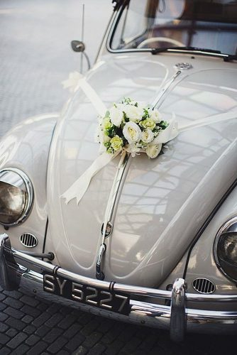 wedding car decorations white ribbons and roses on the hood of a car yu hsin of tinydot photography