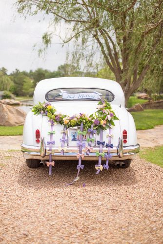 wedding car decorations with flowers and ribbons with bows ely fair photography