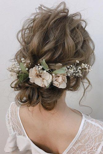 wedding hairstyles with flowers airy curly updo with baby breath and pink petals crown cloud9.hair