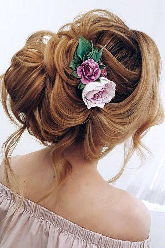 wedding hairstyles with flowers elegant updo on long red hair with pink roses ksenya_makeup