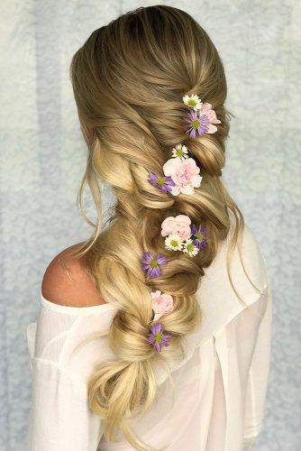 wedding hairstyles with flowers loose braided hairdo with flowers styles_by_reneemarie via instagram