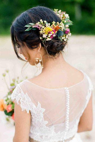 wedding hairstyles with flowers low updo on black hair with bright flowers dana fernandez photography