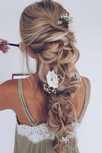 wedding hairstyles with flowers messy boho long braid on blonde hair with white roses hairbyhannahtaylor