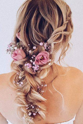 wedding hairstyles with flowers messy boho updo with pink roses and baby breath hairbyhannahtaylor